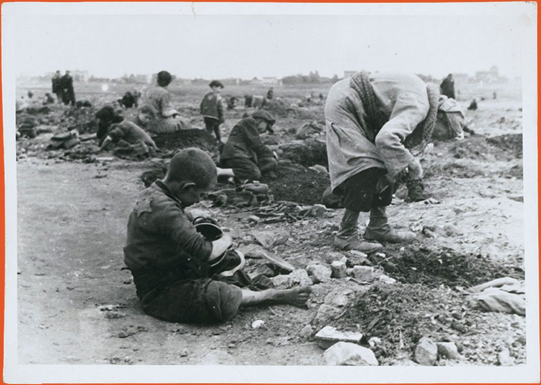 Children searching for and gathering coal