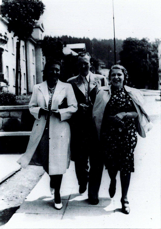 Three friends walking down the street