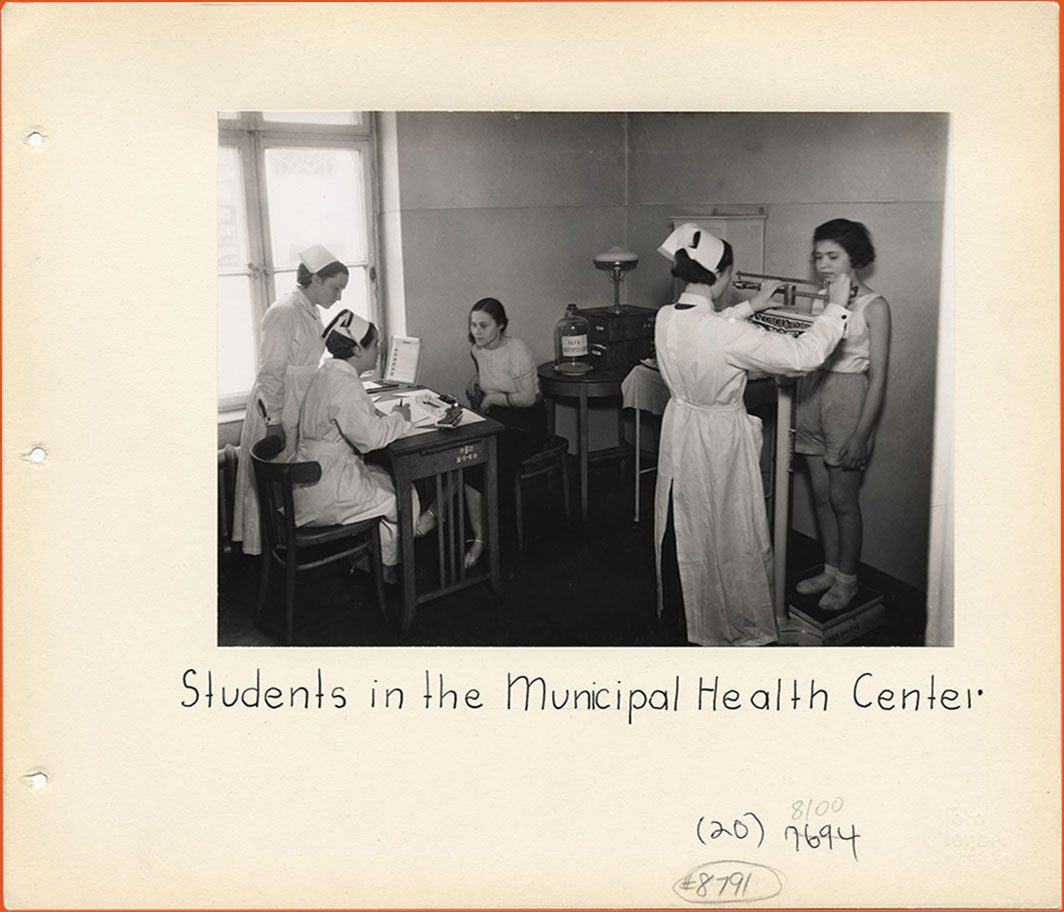 Nurses helping patients
