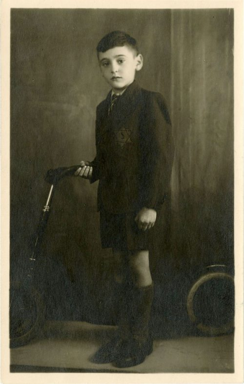 Young boy wearing a yellow star
