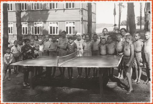 Children playing and watching ping pong game
