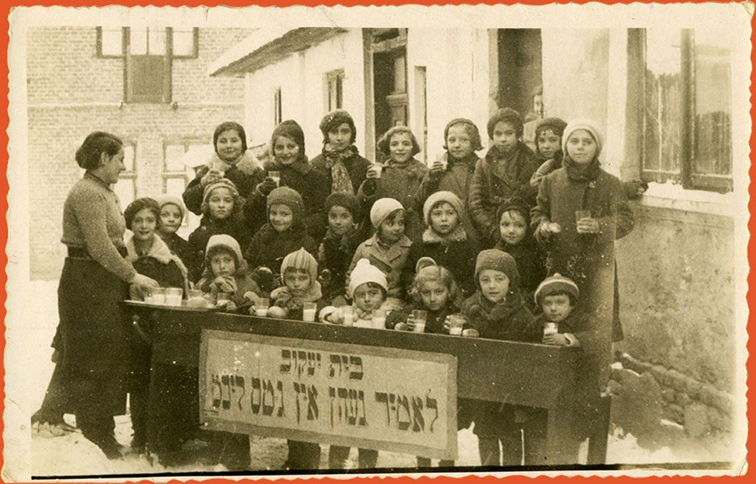 Children pose outside with glasses of milk