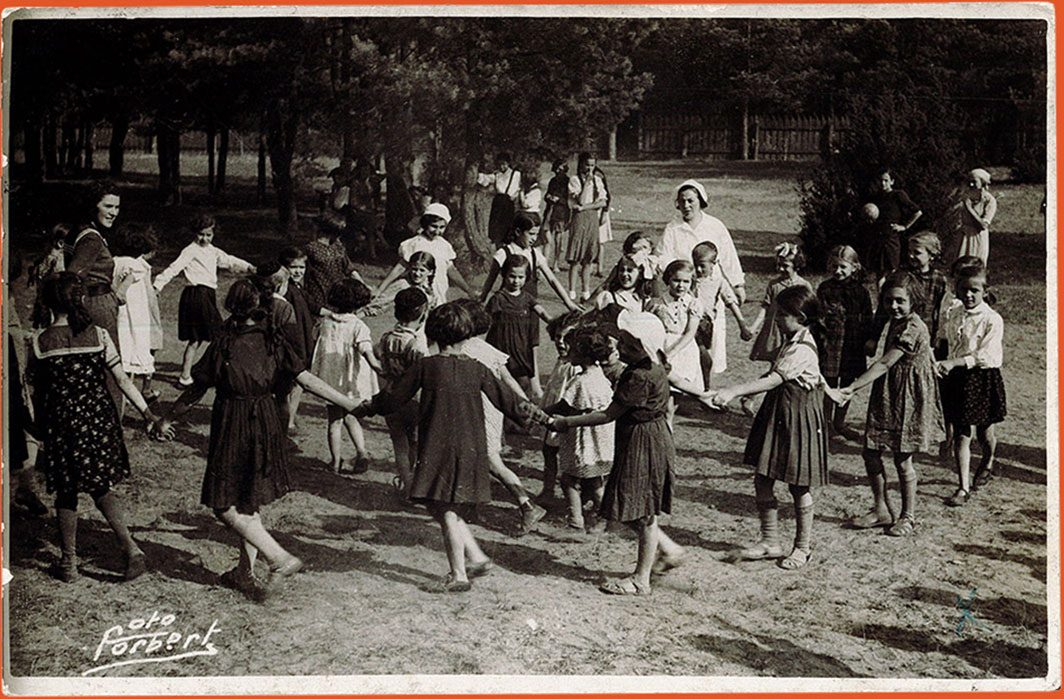 Girls dancing together in a circle