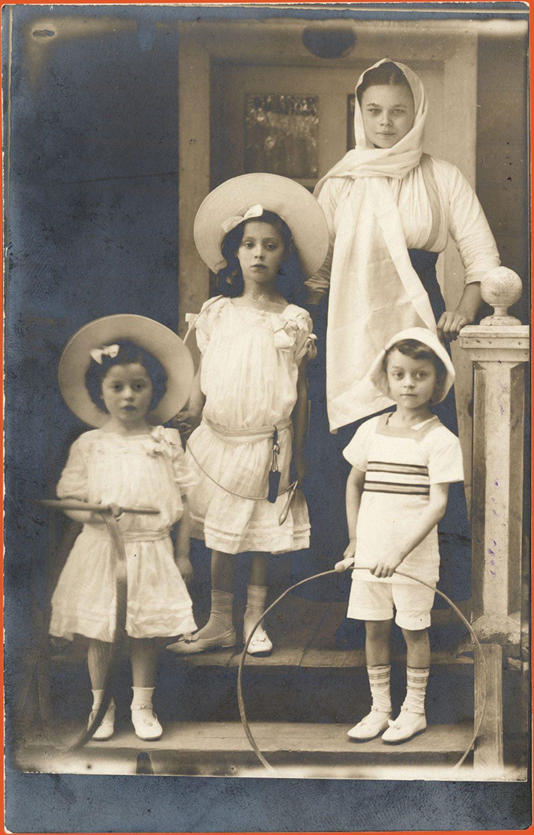 Three children in resort attire