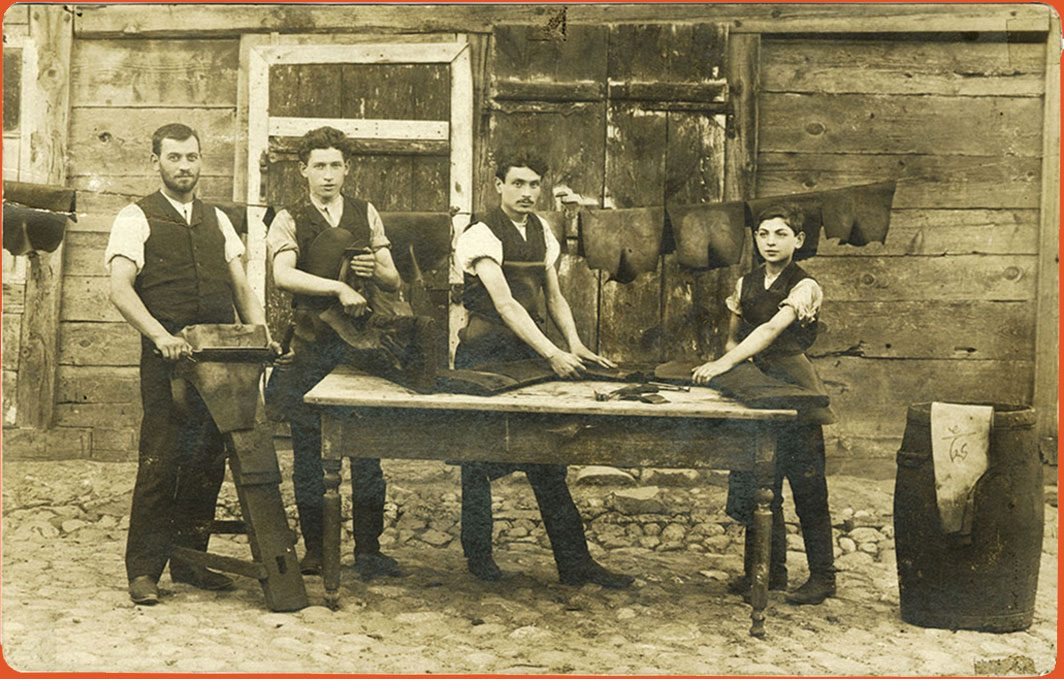 Four young leather workers outdoors