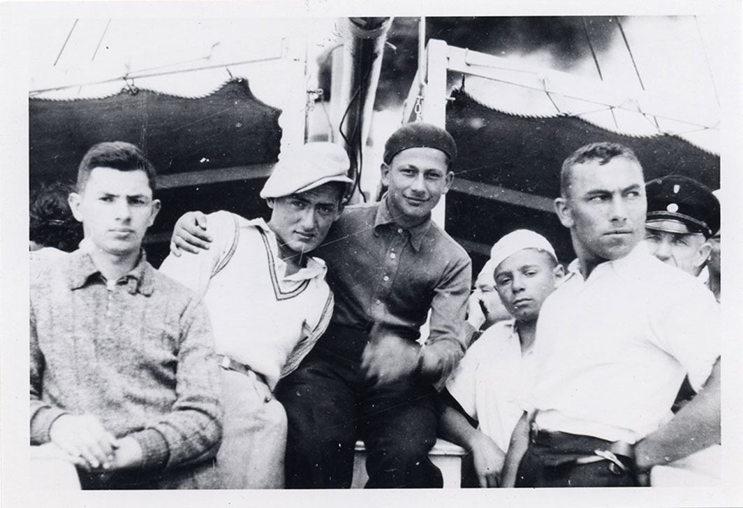 Young men posing on a boat