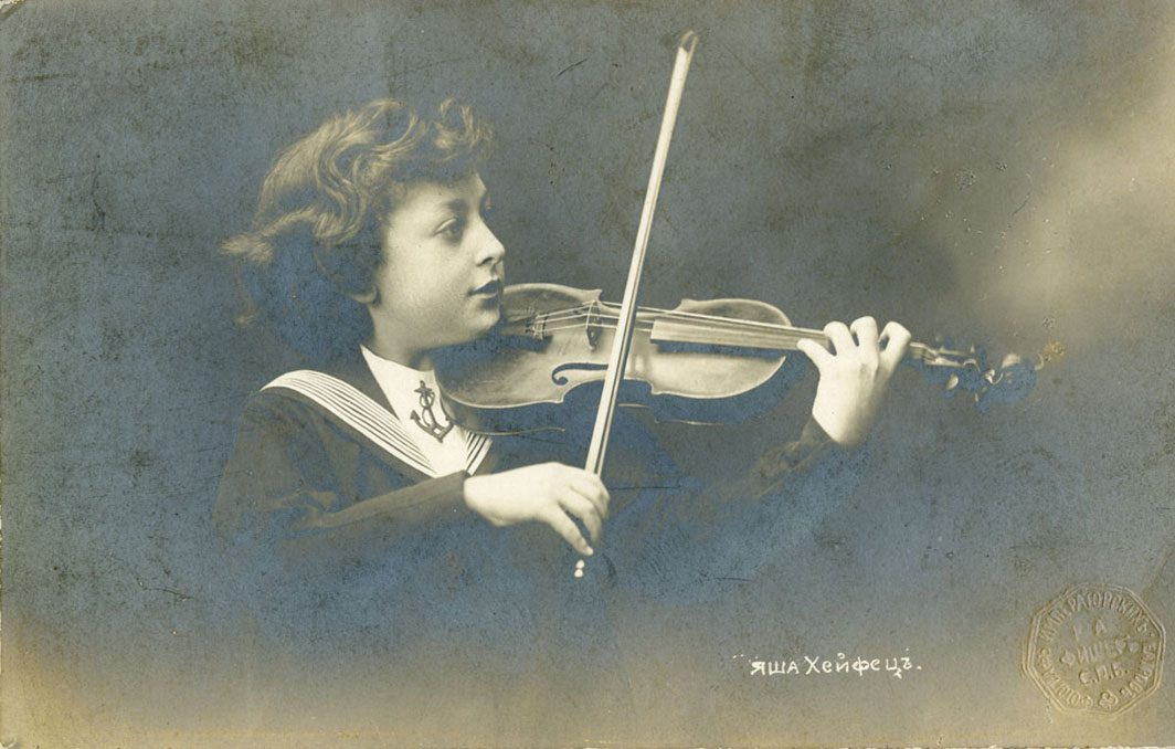 A young musician posing with violin