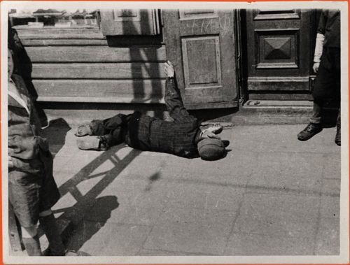 A boy collapsed on the street in the Lodz Ghetto