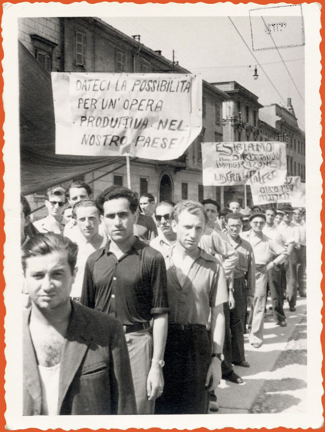 Photograph of demonstrators marching with signs